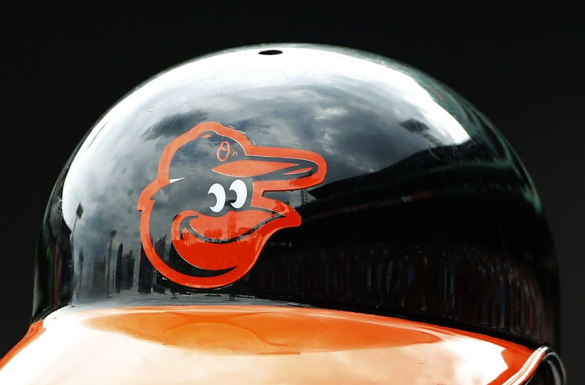 BOSTON, MA - JUNE 25: The Baltimore Orioles logo is seen on a batting helmet during the game between the Boston Red Sox and the Baltimore Orioles at Fenway Park on June 25, 2015 in Boston, Massachusetts. (Photo by Winslow Townson/Getty Images)