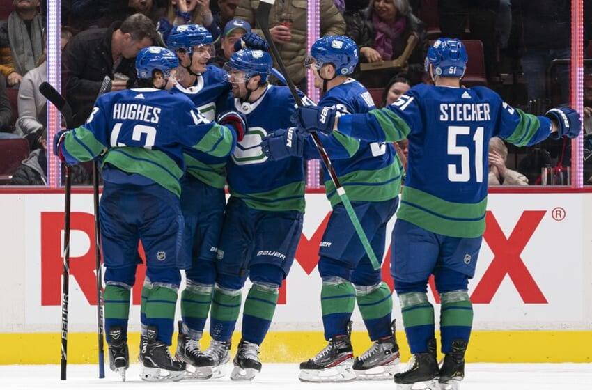 VANCOUVER, BC - JANUARY 18: Loui Eriksson #21 of the Vancouver Canucks is congratulated by teammates Quinn Hughes #43, Tanner Pearson #70, Bo Horvat#53 and Troy Stecher #51 after scoring a goal against the San Jose Sharks in NHL action on January, 18, 2020 at Rogers Arena in Vancouver, British Columbia, Canada. (Photo by Rich Lam/Getty Images)