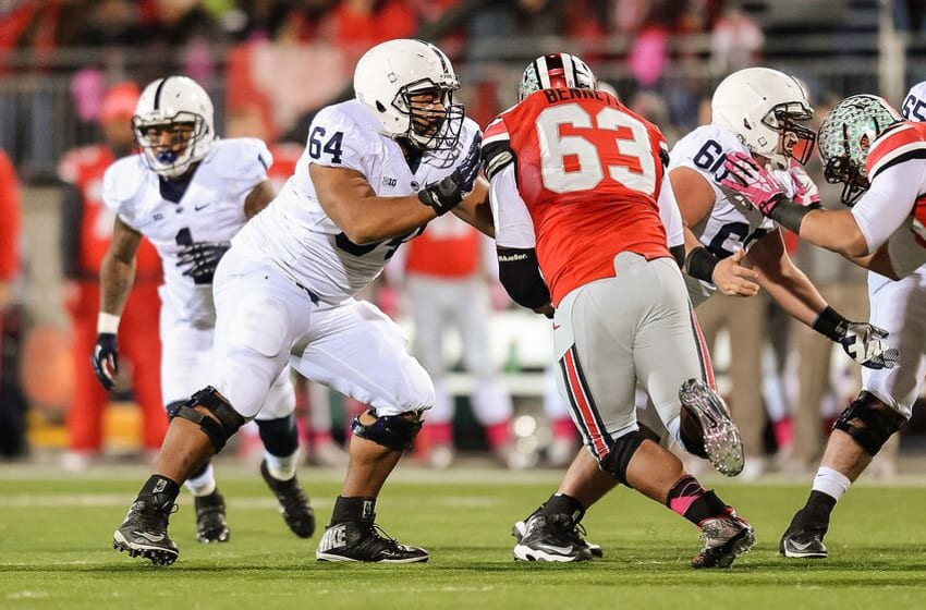 COLUMBUS, OH - OCTOBER 26: John Urschel #64 of the Penn State Nittany Lions blocks against the Ohio State Buckeyes at Ohio Stadium on October 26, 2013 in Columbus, Ohio. (Photo by Jamie Sabau/Getty Images)