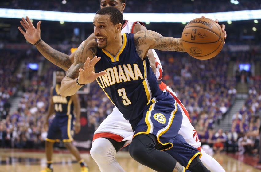 Apr 18, 2016; Toronto, Ontario, CAN; Indiana Pacers guard George Hill (3) drives to the basket against Toronto Raptors guard DeMar DeRozan (10) in game two of the first round of the 2016 NBA Playoffs at Air Canada Centre. The Raptors beat the Pacers 98-87. Mandatory Credit: Tom Szczerbowski-USA TODAY Sports