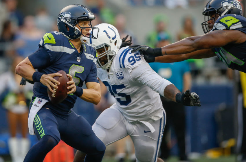 SEATTLE, WA - AUGUST 09: Quarterback Austin Davis #6 of the Seattle Seahawks scrambles under pressure from defensive end Denico Autry #95 of the Indianapolis Colts at CenturyLink Field on August 9, 2018 in Seattle, Washington. (Photo by Otto Greule Jr/Getty Images)