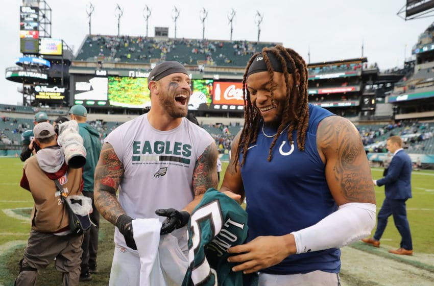 PHILADELPHIA, PA - SEPTEMBER 23: (L-R) Defensive end Chris Long #56 of the Philadelphia Eagles swaps jerseys with defensive end Jabaal Sheard #93 of the Indianapolis Colts after the Eagles 20-16 win at Lincoln Financial Field on September 23, 2018 in Philadelphia, Pennsylvania. (Photo by Elsa/Getty Images)