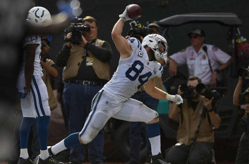 OAKLAND, CA - OCTOBER 28: Jack Doyle #84 of the Indianapolis Colts celebrates by slamming the ball to the ground after he scored a touchdown against the Oakland Raiders during the second half of their NFL football game at Oakland-Alameda County Coliseum on October 28, 2018 in Oakland, California. (Photo by Thearon W. Henderson/Getty Images)