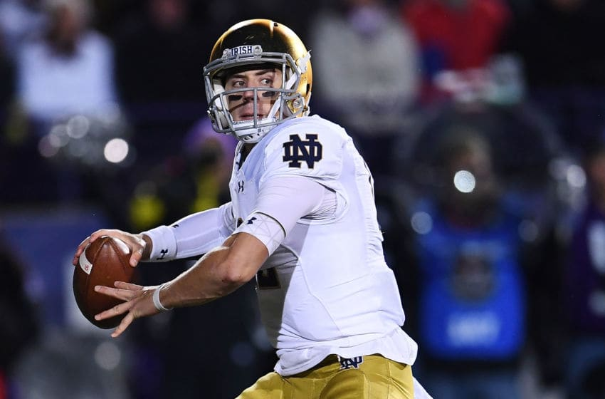 EVANSTON, IL - NOVEMBER 03: Ian Book #12 of the Notre Dame Fighting Irish looks to pass during the second half of a game against the Northwestern Wildcats at Ryan Field on November 3, 2018 in Evanston, Illinois. (Photo by Stacy Revere/Getty Images)