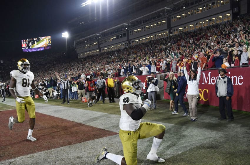 LOS ANGELES, CA - NOVEMBER 24: Tony Jones Jr. #6 of the Notre Dame Fighting Irish celebrates after scoring a touchdown against USC Trojans during the second half at Los Angeles Memorial Coliseum on November 24, 2018 in Los Angeles, California. (Photo by Kevork Djansezian/Getty Images)