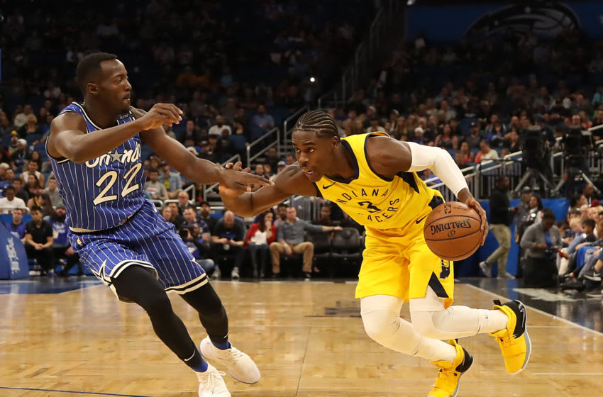 ORLANDO, FLORIDA - DECEMBER 07: Aaron Holiday #3 of the Indiana Pacers drives against Jerian Grant #22 of the Orlando Magic during the game at Amway Center on December 07, 2018 in Orlando, Florida. NOTE TO USER: User expressly acknowledges and agrees that, by downloading and or using this photograph, User is consenting to the terms and conditions of the Getty Images License Agreement. (Photo by Sam Greenwood/Getty Images)