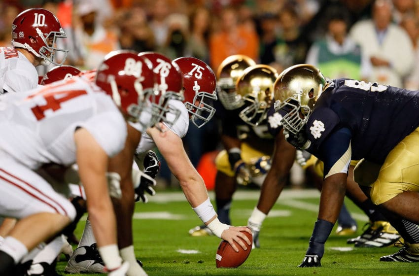 MIAMI GARDENS, FL - JANUARY 07: AJ McCarron #10 of the Alabama Crimson Tide lines up under his center Barrett Jones #75 against the Notre Dame Fighting Irish during the 2013 Discover BCS National Championship game at Sun Life Stadium on January 7, 2013 in Miami Gardens, Florida. (Photo by Kevin C. Cox/Getty Images)