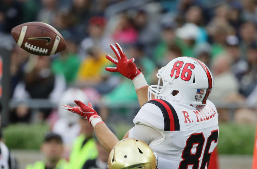 SOUTH BEND, IN - SEPTEMBER 08: Riley Miller #86 of the Ball State Cardinals attempts a catch against Troy Pride Jr. #5 of the Notre Dame Fighting Irish at Notre Dame Stadium on September 8, 2018 in South Bend, Indiana. Notre Dame defeated Ball State 24-16.(Photo by Jonathan Daniel/Getty Images)