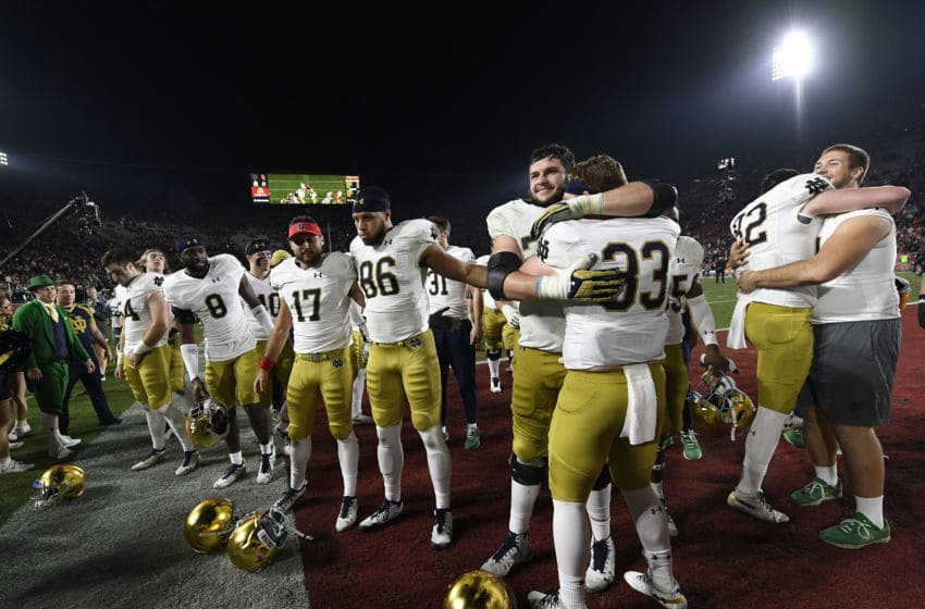 LOS ANGELES, CA - NOVEMBER 24: Notre Dame Fighting Irish players celebrate after defeating USC Trojans 24-17 at Los Angeles Memorial Coliseum on November 24, 2018 in Los Angeles, California. (Photo by Kevork Djansezian/Getty Images)