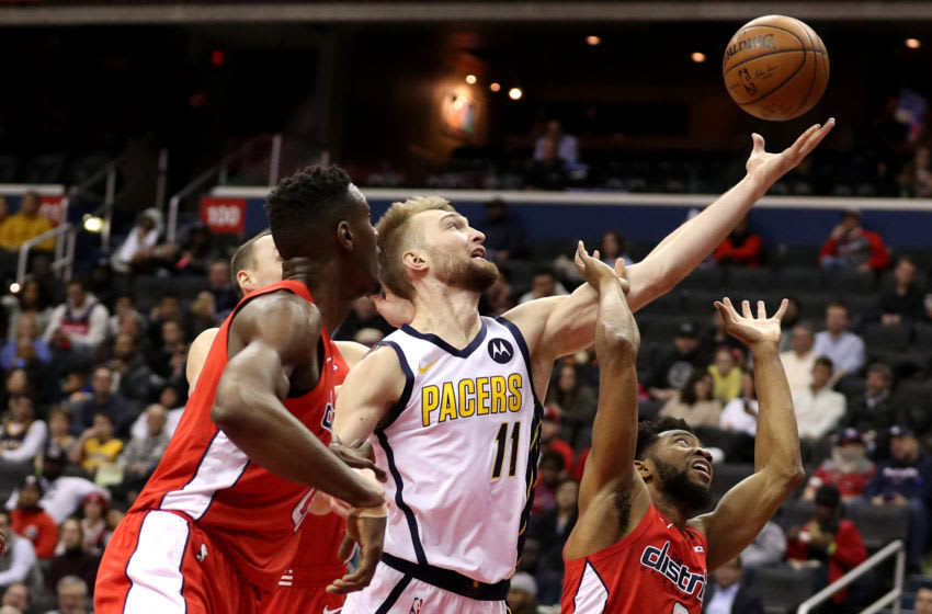 WASHINGTON, DC - JANUARY 30: Domantas Sabonis #11 of the Indiana Pacers gets a rebound in front of multiple Washington Wizards defenders during the first half at Capital One Arena on January 30, 2019 in Washington, DC. (Photo by Patrick Smith/Getty Images)
