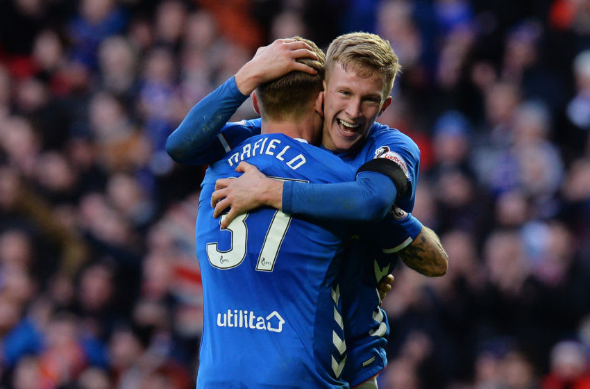 GLASGOW, SCOTLAND - DECEMBER 29: Ross McCrorie and Scott Arfield of Rangers celebrates at the final whistle as Rangers beat Celtic 1-0 during the Ladbrokes Scottish Premiership match between Rangers and Celtic at Ibrox Stadium on December 29, 2018 in Glasgow, Scotland. (Photo by Mark Runnacles/Getty Images)