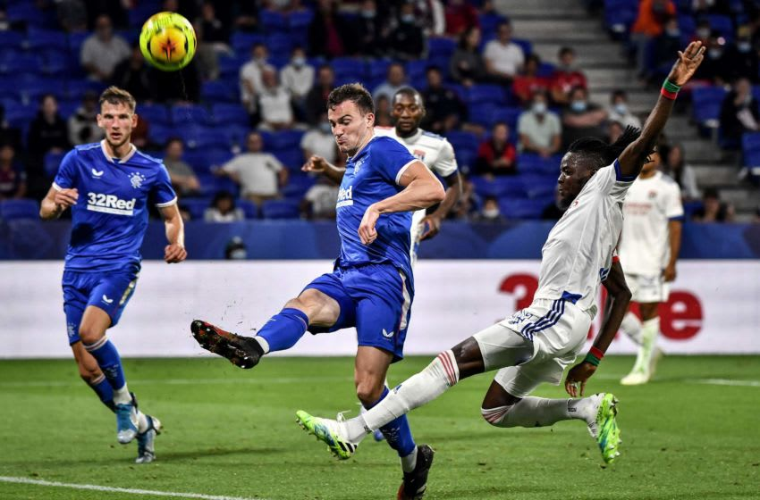 Rangers FC's English defender George Edmundson (L) vies with LyonÕs Burkinabe forward Bertrand Traore (R) during the French Lyon friendly tournament football match Olympique Lyonnais (OL) vs Glasgow Rangers FC on July 16, 2020 at the Groupama stadium in Decines-Charpieu, central-eastern France. - Lyon's main supporters group said on Tuesday they will give up their seats to health workers for a tournament including Celtic, Rangers and fellow French club Nice this week. The friendly competition is being used by Rudi Garcia's side ahead of August's Champions League last 16 second leg tie at Juventus which the Ligue 1 outfit lead 1-0. Only 5,000 people will be allowed for the fixtures at the Groupama Stadium between July 16-18 due to coronavirus restrictions. (Photo by JEFF PACHOUD / AFP) (Photo by JEFF PACHOUD/AFP via Getty Images)