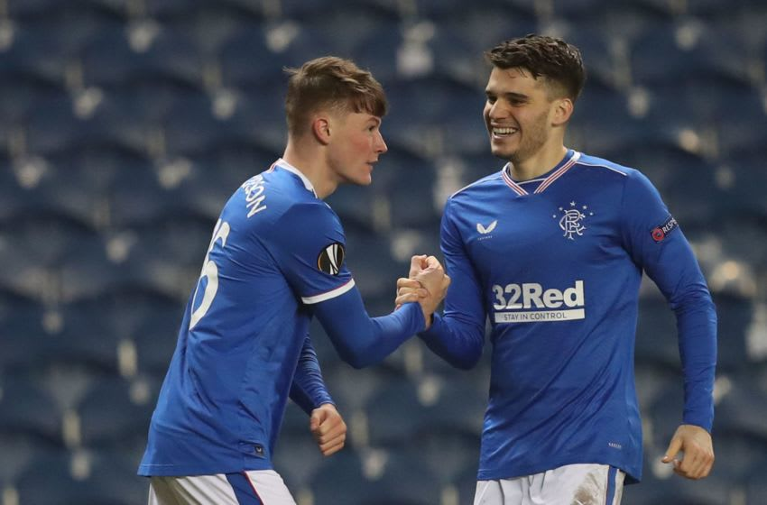 Rangers' Scottish defender Nathan Patterson (L) celebrates with Rangers' Romanian midfielder Ianis Hagi (R) after scoring their second goal during the UEFA Europa League Round of 32, 2nd leg football match between Rangers and Royal Antwerp at the Ibrox Stadium in Glasgow on February 25, 2021. (Photo by RUSSELL CHEYNE / POOL / AFP) (Photo by RUSSELL CHEYNE/POOL/AFP via Getty Images)
