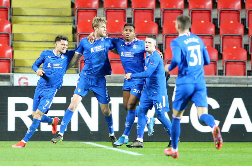 Rangers' Swedish defender Filip Helander (2nd L) celebrates scoring with his team-mates during the UEFA Europa League, last 16, first Leg football match Slavia Prague v Rangers at the Eden Arena stadium in Prague, Czech Republic, on March 11, 2021. (Photo by Milan Kammermayer / AFP) (Photo by MILAN KAMMERMAYER/AFP via Getty Images)