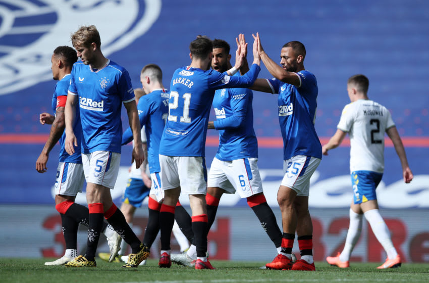 Kemar Roofe of Rangers FC celebrates with teammates after scoring his team's first goal. (Photo by Ian MacNicol/Getty Images)