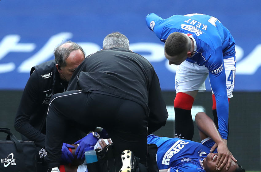 GLASGOW, SCOTLAND - SEPTEMBER 12: Alfredo Morelos of Rangers receives medical treatment during the Ladbrokes Scottish Premiership match between Rangers and Dundee United at Ibrox Stadium on September 12, 2020 in Glasgow, Scotland. (Photo by Ian MacNicol/Getty Images)