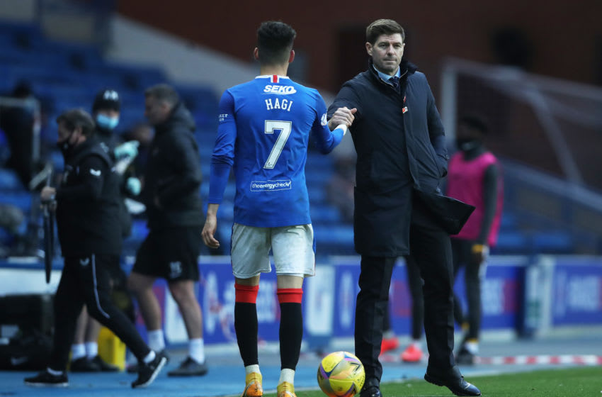 GLASGOW, SCOTLAND - OCTOBER 25: Steven Gerrard, manager of Rangers interacts with Ianis Hagi of Rangers during the Ladbrokes Scottish Premiership match between Rangers and Livingston at Ibrox Stadium on October 25, 2020 in Glasgow, Scotland. Sporting stadiums around the UK remain under strict restrictions due to the Coronavirus Pandemic as Government social distancing laws prohibit fans inside venues resulting in games being played behind closed doors. (Photo by Ian MacNicol/Getty Images)