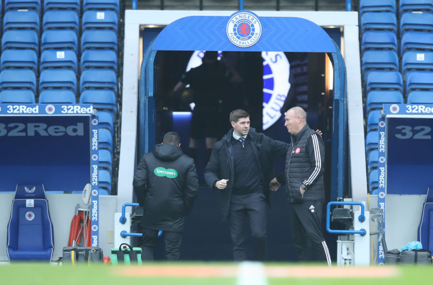 GLASGOW, SCOTLAND - NOVEMBER 08: Steven Gerrard, Manager of Rangers interacts with Brian Rice, manager of Hamilton Academical ahead of the Ladbrokes Scottish Premiership match between Rangers and Hamilton Academical at Ibrox Stadium on November 08, 2020 in Glasgow, Scotland. Sporting stadiums around the UK remain under strict restrictions due to the Coronavirus Pandemic as Government social distancing laws prohibit fans inside venues resulting in games being played behind closed doors. (Photo by Ian MacNicol/Getty Images)