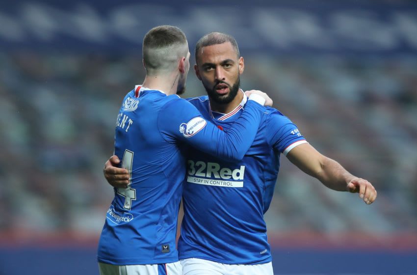GLASGOW, SCOTLAND - NOVEMBER 08: Kemar Roofe of Rangers celebrates with team mate Ryan Kent after scoring his sides second goal during the Ladbrokes Scottish Premiership match between Rangers and Hamilton Academical at Ibrox Stadium on November 08, 2020 in Glasgow, Scotland. Sporting stadiums around the UK remain under strict restrictions due to the Coronavirus Pandemic as Government social distancing laws prohibit fans inside venues resulting in games being played behind closed doors. (Photo by Ian MacNicol/Getty Images)