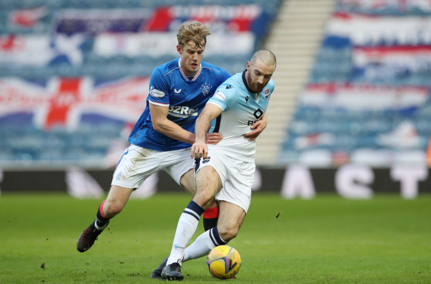GLASGOW, SCOTLAND - JANUARY 23: Ross Draper of Ross County is challenged by Filip Helander of Rangers during the Ladbrokes Scottish Premiership match between Rangers Ross County at Ibrox Stadium on January 23, 2021 in Glasgow, Scotland. Sporting stadiums around the UK remain under strict restrictions due to the Coronavirus Pandemic as Government social distancing laws prohibit fans inside venues resulting in games being played behind closed doors. (Photo by Ian MacNicol/Getty Images)