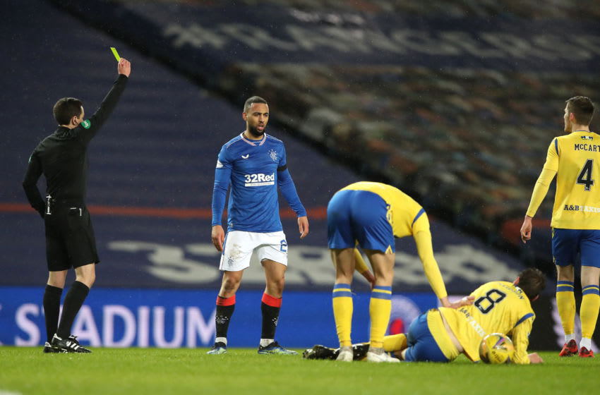 GLASGOW, SCOTLAND - FEBRUARY 03: Rangers player Kemar Roofe is yellow carded by referee David Munro after a challenge on Murray Davidson of St Johnstone (#8) during the Ladbrokes Scottish Premiership match between Rangers and St Johnstone at Ibrox Stadium on February 03, 2021 in Glasgow, Scotland. Sporting stadiums around the UK remain under strict restrictions due to the Coronavirus Pandemic as Government social distancing laws prohibit fans inside venues resulting in games being played behind closed doors. (Photo by Ian MacNicol/Getty Images)