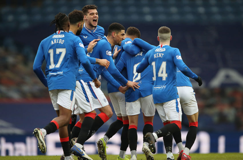 GLASGOW, SCOTLAND - FEBRUARY 13: Ianis Hagi of Rangers is seen as team mate congratulate Ryan Jack of Rangers after scoring their side's first goal during the Ladbrokes Scottish Premiership match between Rangers and Kilmarnock at Ibrox Stadium on February 13, 2021 in Glasgow, Scotland. Sporting stadiums around the UK remain under strict restrictions due to the Coronavirus Pandemic as Government social distancing laws prohibit fans inside venues resulting in games being played behind closed doors. (Photo by Ian MacNicol/Getty Images)