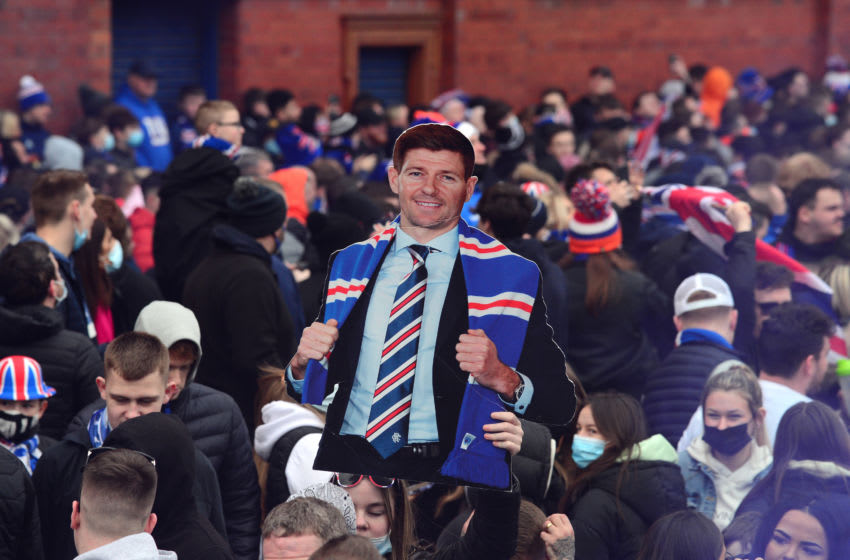 GLASGOW, SCOTLAND - MARCH 07: A cardboard cut out of Rangers Manager, Steven Gerrard is seen in the crowd as Rangers fans, gather outside the Ibrox Stadium, to celebrate their team winning the Scottish Premiership title on March 07, 2021 in Glasgow, Scotland. (Photo by Mark Runnacles/Getty Images)