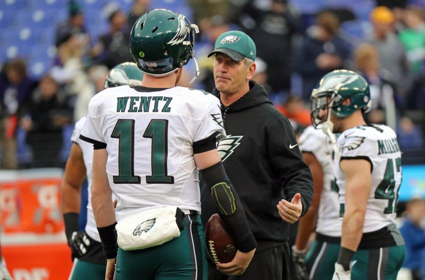 Dec 18, 2016; Baltimore, MD, USA; Philadelphia Eagles quarterback Carson Wentz (11) talks with offensive coordinator Frank Reich prior to the game against Baltimore Ravens at M&T Bank Stadium. Mandatory Credit: Mitch Stringer-USA TODAY Sports