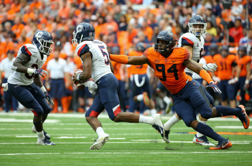 SYRACUSE, NY - SEPTEMBER 22: Alton Robinson #94 of the Syracuse Orange pressures David Pindell #5 of the Connecticut Huskies during the first quarter at the Carrier Dome on September 22, 2018 in Syracuse, New York. (Photo by Rich Barnes/Getty Images)
