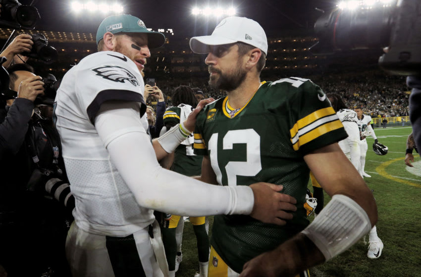GREEN BAY, WISCONSIN - SEPTEMBER 26: Carson Wentz #11 of the Philadelphia Eagles and Aaron Rodgers #12 of the Green Bay Packers meet after the Eagles beat the Packers 34-27 at Lambeau Field on September 26, 2019 in Green Bay, Wisconsin. (Photo by Dylan Buell/Getty Images)