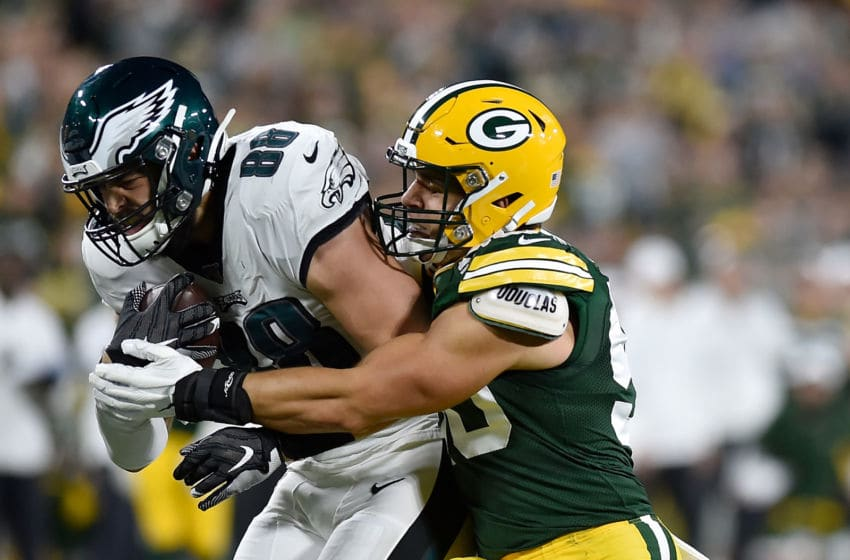 GREEN BAY, WISCONSIN - SEPTEMBER 26: Blake Martinez #50 of the Green Bay Packers tackles Dallas Goedert #88 of the Philadelphia Eagles in the third quarter at Lambeau Field on September 26, 2019 in Green Bay, Wisconsin. (Photo by Quinn Harris/Getty Images)