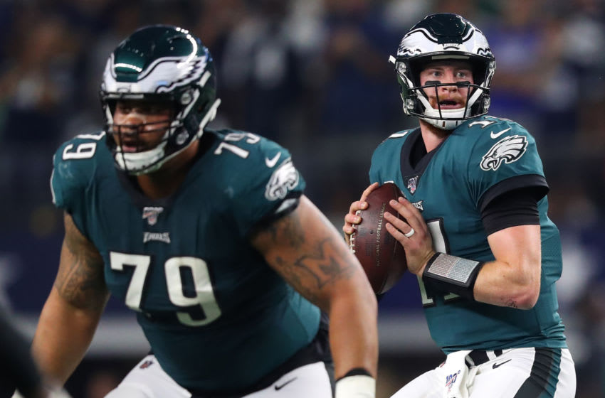 ARLINGTON, TEXAS - OCTOBER 20: Carson Wentz #11 of the Philadelphia Eagles looks to pass as Brandon Brooks #79 blocks during the first half against the Dallas Cowboys in the game at AT&T Stadium on October 20, 2019 in Arlington, Texas. (Photo by Tom Pennington/Getty Images)