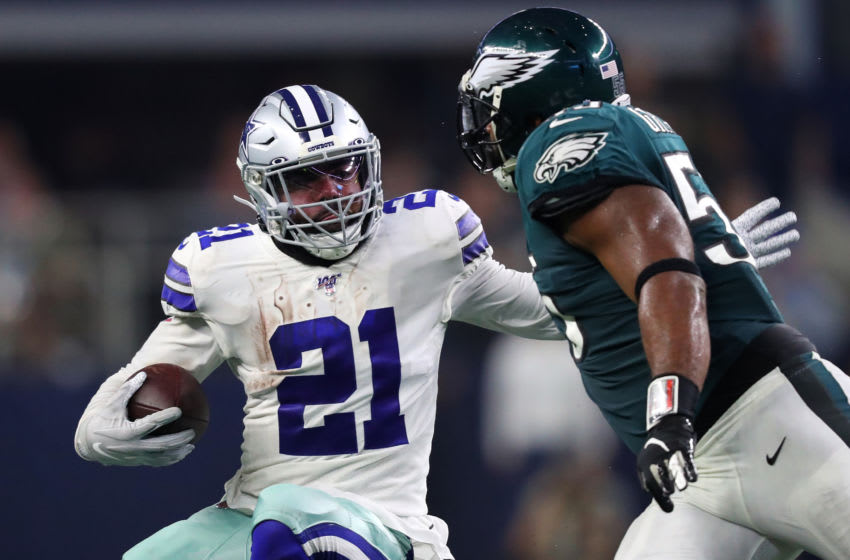 ARLINGTON, TEXAS - OCTOBER 20: Ezekiel Elliott #21 of the Dallas Cowboys runs with the ball during the first half against Brandon Graham #55 of the Philadelphia Eagles in the game at AT&T Stadium on October 20, 2019 in Arlington, Texas. (Photo by Tom Pennington/Getty Images)