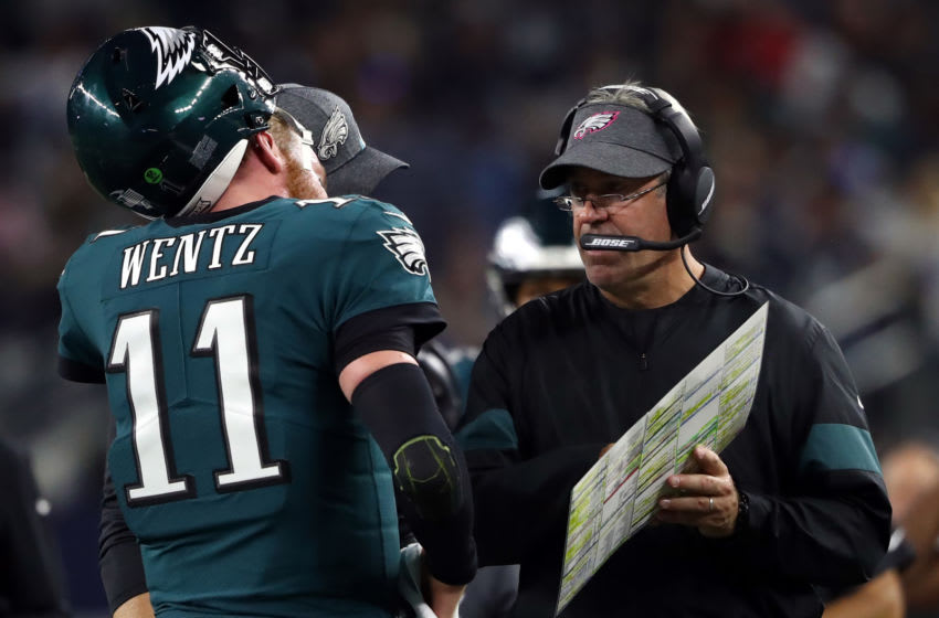 ARLINGTON, TEXAS - OCTOBER 20: Head coach Doug Pederson talks with Carson Wentz #11 of the Philadelphia Eagles in the second half at AT&T Stadium on October 20, 2019 in Arlington, Texas. (Photo by Ronald Martinez/Getty Images)