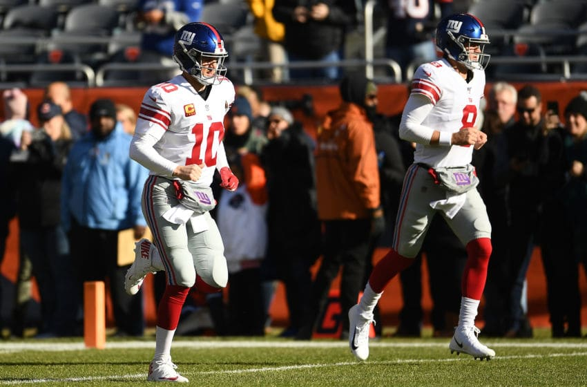 CHICAGO, ILLINOIS - NOVEMBER 24: Eli Manning #10 and Daniel Jones #8 of the New York Giants take the field for warmups prior to a game against the Chicago Bears at Soldier Field on November 24, 2019 in Chicago, Illinois. (Photo by Stacy Revere/Getty Images)