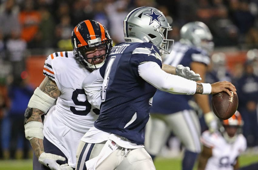 CHICAGO, ILLINOIS - DECEMBER 05: Aaron Lynch #99 of the Chicago Bears hits Dak Prescott #4 of the Dallas Cowboys forcing a intentional grounding call against Prescott at Soldier Field on December 05, 2019 in Chicago, Illinois. The Bears defeated the Cowboys 31-24. (Photo by Jonathan Daniel/Getty Images)