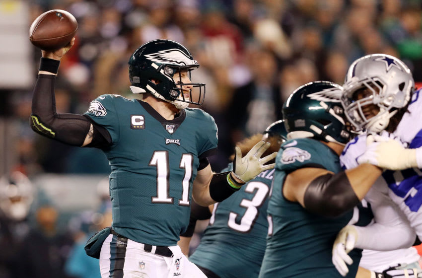 PHILADELPHIA, PENNSYLVANIA - DECEMBER 22: Carson Wentz #11 of the Philadelphia Eagles throws a pass during the first half against the Dallas Cowboys in the game at Lincoln Financial Field on December 22, 2019 in Philadelphia, Pennsylvania. (Photo by Patrick Smith/Getty Images)