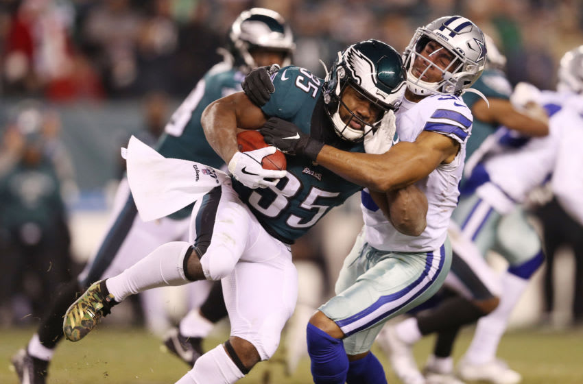 PHILADELPHIA, PENNSYLVANIA - DECEMBER 22: Byron Jones #31 of the Dallas Cowboys tackles Boston Scott #35 of the Philadelphia Eagles on a kickoff return during the fourth quarter in the game at Lincoln Financial Field on December 22, 2019 in Philadelphia, Pennsylvania. (Photo by Patrick Smith/Getty Images)
