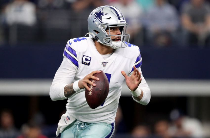 ARLINGTON, TEXAS - DECEMBER 29: Dak Prescott #4 of the Dallas Cowboys drops back to pass in the first quarter against the Washington Redskins in the game at AT&T Stadium on December 29, 2019 in Arlington, Texas. (Photo by Tom Pennington/Getty Images)