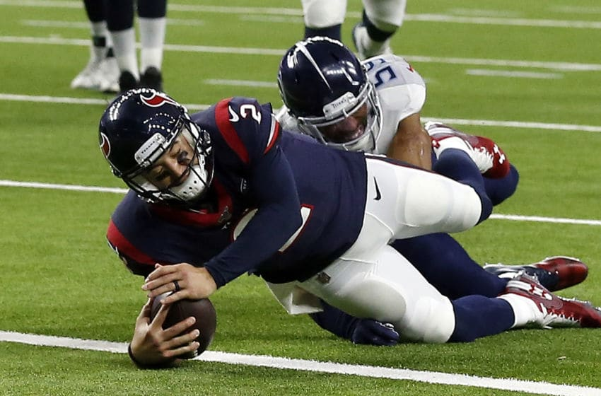 HOUSTON, TEXAS - DECEMBER 29: AJ McCarron #2 of the Houston Texans runs for a touchdown during the third quarter against the Tennessee Titans at NRG Stadium on December 29, 2019 in Houston, Texas. (Photo by Bob Levey/Getty Images)