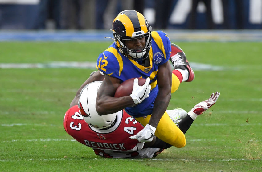 LOS ANGELES, CA - DECEMBER 29: Wide receiver Brandin Cooks #12 of the Los Angeles Rams hangs on to a complete pass before he is stopped by outside linebacker Haason Reddick #43 of the Arizona Cardinals in the second half of the game at the Los Angeles Memorial Coliseum on December 29, 2019 in Los Angeles, California. (Photo by Jayne Kamin-Oncea/Getty Images)