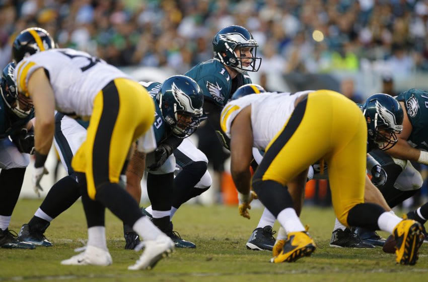 PHILADELPHIA, PA - SEPTEMBER 25: Quarterback Carson Wentz #11 of the Philadelphia Eagles satnds under center for the snap against the Pittsburgh Steelers in the third quarter at Lincoln Financial Field on September 25, 2016 in Philadelphia, Pennsylvania. (Photo by Rich Schultz/Getty Images)
