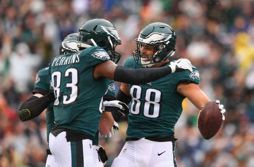 PHILADELPHIA, PA - SEPTEMBER 23: Tight end Dallas Goedert #88 of the Philadelphia Eagles celebrates with teammates tight end Josh Perkins #83 and quarterback Carson Wentz #11 after Goedert made a catch for a touchdown against the Indianapolis Colts in the first quarter at Lincoln Financial Field on September 23, 2018 in Philadelphia, Pennsylvania. (Photo by Mitchell Leff/Getty Images)