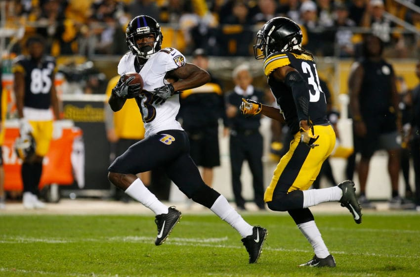 PITTSBURGH, PA - SEPTEMBER 30: John Brown #13 of the Baltimore Ravens runs upfield after a catch as Terrell Edmunds #34 of the Pittsburgh Steelers pursues in the first half during the game at Heinz Field on September 30, 2018 in Pittsburgh, Pennsylvania. (Photo by Justin K. Aller/Getty Images)