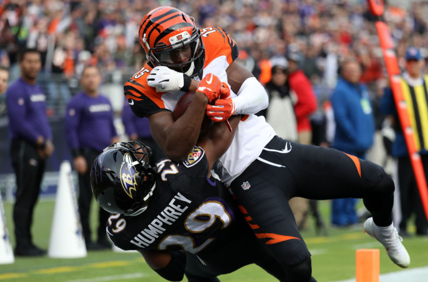 BALTIMORE, MD - NOVEMBER 18: Wide Receiver John Ross #15 of the Cincinnati Bengals catches a touchdown as he is tackled by cornerback Marlon Humphrey #29 of the Baltimore Ravens in the third quarter at M&T Bank Stadium on November 18, 2018 in Baltimore, Maryland. (Photo by Rob Carr/Getty Images)