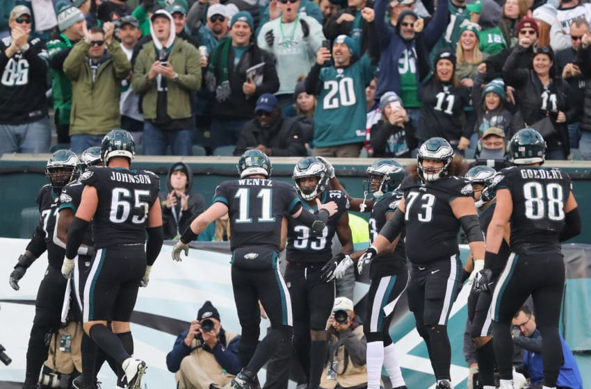 PHILADELPHIA, PA - NOVEMBER 25: Running back Josh Adams #33 of the Philadelphia Eagles celebrates his touchdown with teammates against the New York Giants during the fourth quarter at Lincoln Financial Field on November 25, 2018 in Philadelphia, Pennsylvania. (Photo by Elsa/Getty Images)