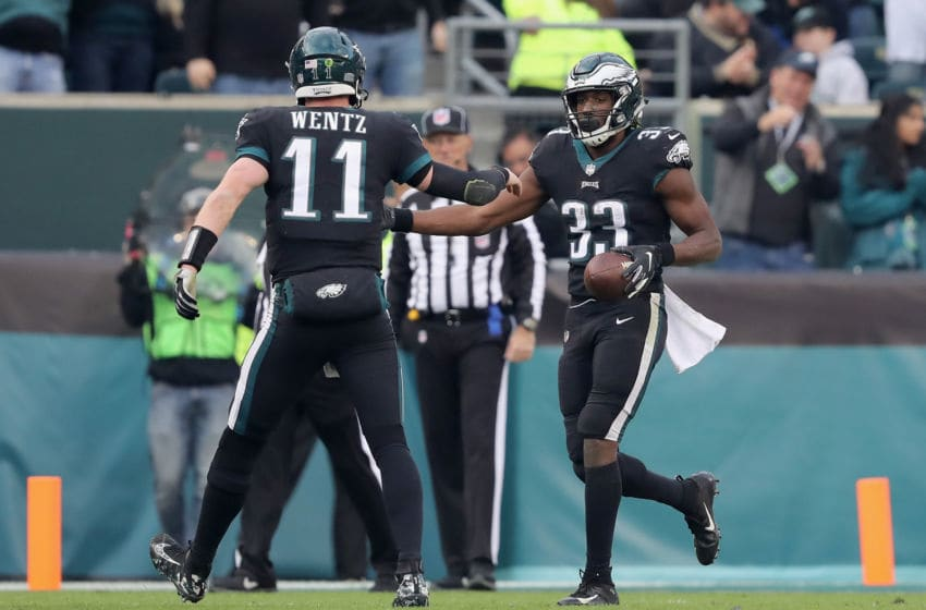 PHILADELPHIA, PA - NOVEMBER 25: Running back Josh Adams #33 of the Philadelphia Eagles celebrates his touchdown with teammate quarterback Carson Wentz #11 against the New York Giants during the fourth quarter at Lincoln Financial Field on November 25, 2018 in Philadelphia, Pennsylvania. (Photo by Elsa/Getty Images)