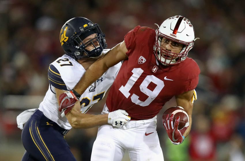 PALO ALTO, CA - NOVEMBER 18: JJ Arcega-Whiteside #19 of the Stanford Cardinal is tackled by Ashtyn Davis #27 of the California Golden Bears at Stanford Stadium on November 18, 2017 in Palo Alto, California. (Photo by Ezra Shaw/Getty Images)