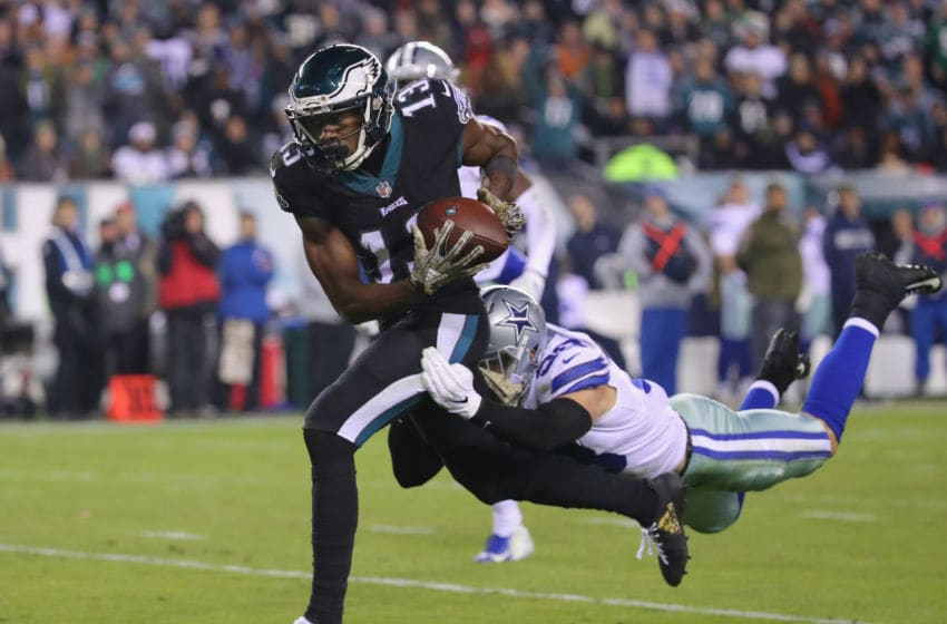 PHILADELPHIA, PA - NOVEMBER 11: Wide receiver Nelson Agholor #13 of the Philadelphia Eagles carries the ball against strong safety Jeff Heath #38 of the Dallas Cowboys during the fourth quarter at Lincoln Financial Field on November 11, 2018 in Philadelphia, Pennsylvania. The Dallas Cowboys won 27-20. (Photo by Brett Carlsen/Getty Images)
