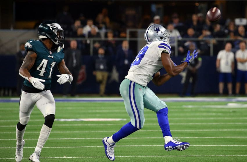 ARLINGTON, TEXAS - DECEMBER 09: DeVante Bausby #41 of the Philadelphia Eagles defends as Amari Cooper #19 of the Dallas Cowboys makes a catch before breaking away on a touchdown run in the fourth quarter at AT&T Stadium on December 09, 2018 in Arlington, Texas. (Photo by Richard Rodriguez/Getty Images)
